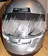 Helmet damaged from frontal impact protected the riders face