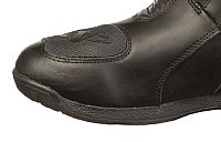 Motorcycle touring boots with gear shifter toe pad